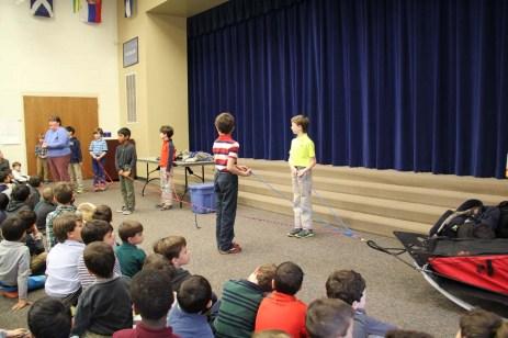 Assembly boys holding line