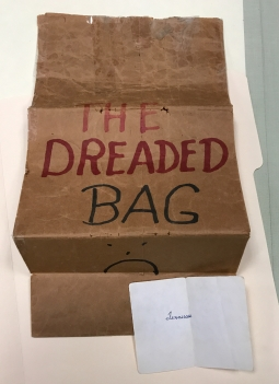 Dreaded bag with paper slip
